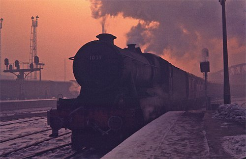 The sun sets on steam . . . an atmospheric study of No. 1009 County of Carmarthen at Bristol in January 1963. The 'County' ended its days at Cashmore's Newport, not Swindon Works as stated in 'What Happened to Steam'. COLOUR-RAIL.COM
