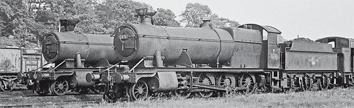 Stored at Aberdare shed with their chimneys capped on July 7, 1963 are ex-GWR 2-8-0s Nos. 2876 and 3816. No. 2876 was taken into Cashmore's Newport on March 22, 1965 for disposal and was not cut up at Bird's of Risca, as has been reported. (Readers' on-shed storage notes are welcomed.) RAIL PHOTOPRINTS