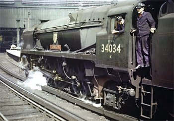 Alive and dead: 'West Country' No. 34034 Honiton at Waterloo in 1965 (top) and at Cashmore's Newport on April 2, 1968. The published records state incorrectly that this loco was scrapped by Buttiegieg's.Top: COLOUR-RAIL.COM Above: R.K. BLENCOWE